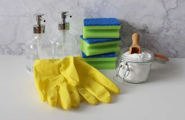 Rubber gloves, sponges, and baking soda for cleaning as part of a New Year's resolution for your home