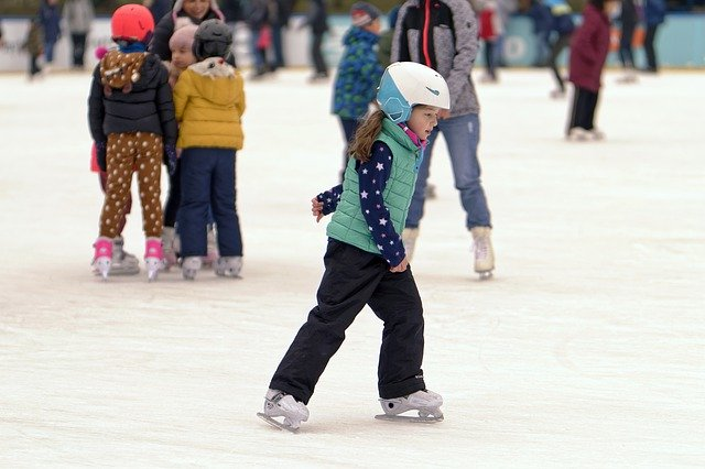 girl ice skating at rink